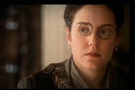 bespectacled Victorian woman reporter's face, looking askance